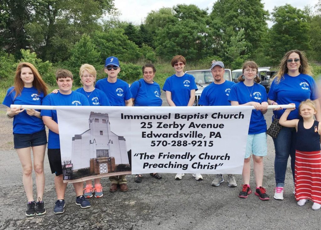 Church members walking in pierogi festival parade June 11.